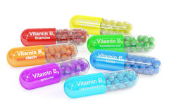 L'insieme della vitamina incapsula B1, B2, B3, B5, B6, B7, B12 rappresentazione 3d Fotografie Stock Libere da Diritti