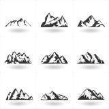 L'insieme delle montagne disegnate a mano profila le icone per il DES di logo Fotografia Stock Libera da Diritti