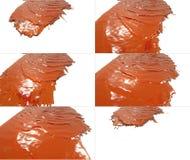 L'insieme di flusso liquido cade su superficie Immagine Stock