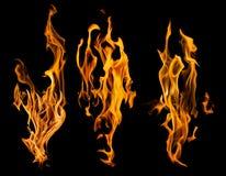 L'insieme di fuoco arancio scintilla su fondo nero Immagini Stock Libere da Diritti