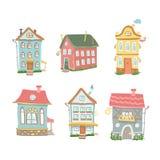 L'insieme sveglio del fumetto delle case disegnate a mano si dirige il dolce Fotografia Stock