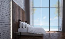 L'interior design ed il muro di mattoni moderni della camera da letto strutturano la vista del mare e del fondo Fotografia Stock