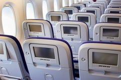 L'interno dell'aeroplano del passeggero con i sedili Fotografie Stock Libere da Diritti