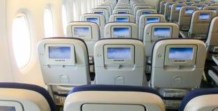 L'interno dell'aeroplano del passeggero con i sedili Fotografia Stock Libera da Diritti