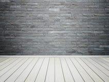 La parete di pietra ed il legno interni della stanza pavimentano il