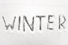 L'inverno firma dentro la neve fotografia stock