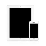 l'Ipad neuf (Ipad 3) et blanc d'iPhone 5 d'isolement Images stock