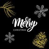 L'iscrizione ed il natale di calligrafia di Buon Natale scarabocchiano su fondo nero Fotografie Stock