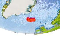 L'Islande en rouge sur le modèle de la terre Photographie stock libre de droits