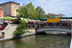 L'Isle sur la Sorgue, Provence , France. L'ISLE SUR LA SORGUE, FRANCE - JUL 13, 2014:Rural market in Beautiful Medieval Village L'Isle sur la Sorgue. The small Stock Photos