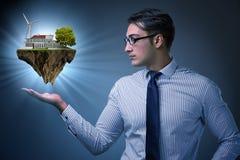 L'isola di volo della tenuta dell'uomo d'affari nel concetto di eco Immagine Stock