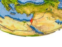 L'Israël en rouge sur le modèle de la terre Images libres de droits