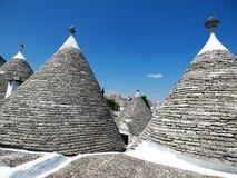 L'Italie, le Pouilles, l'Alberobello et son trulli photos stock