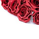 L mazzo delle rose rosse su un fondo bianco Fotografia Stock