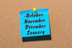 L'an neuf est prochain concept Début de janvier et décembre, novembre, idée de fin d'octobre sur le fond de panneau d'affichage Photographie stock libre de droits