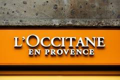 L`occitane en Provence logo on a wall. Milan, Italy - April 13, 2016: L`occitane en Provence logo on a wall. L`occitane en Provence is an international retailer stock image