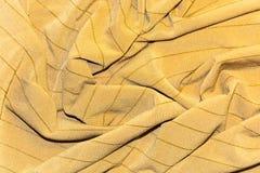L'ocraceo a strisce coperto tessuto tricottato Fotografia Stock Libera da Diritti