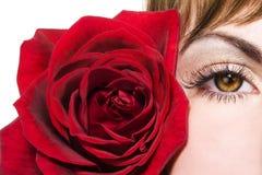 L'oeil et le rouge de femme se sont levés Photos libres de droits
