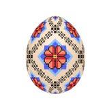 L'oeuf de pâques avec le modèle ethnique de point de croix ukrainien images stock
