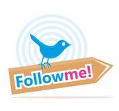 L'oiseau avec me suivent signe Photo stock