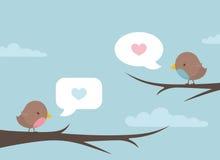 L'oiseau parlent la branche Images stock