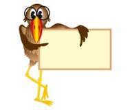L'oiseau retient le panneau-réclame Photos stock