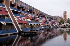 L'olandese alloggia la riflessione sull'acqua Immagini Stock
