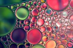 L'olio cade la priorità bassa astratta Immagini Stock