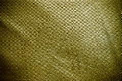 L'olive a troué et a plissé le fond ou la texture de toile Image stock