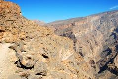 L'Oman, paesaggio delle montagne di grande canyon dell'Oman Fotografie Stock Libere da Diritti