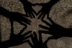 L'ombra delle mani insieme Fotografia Stock Libera da Diritti