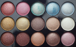 L'ombre de palette observe le fond de maquillage Images libres de droits
