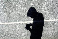 L'ombre du garçon sur le mur Photographie stock libre de droits