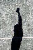 L'ombre du garçon sur le mur Photographie stock