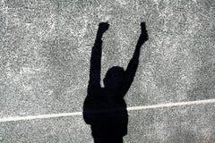 L'ombre du garçon sur le mur Images libres de droits