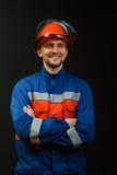 L'operaio in camici ed in un casco Fotografia Stock