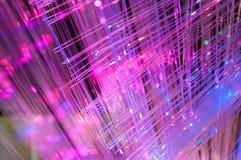L'optique des fibres allume le fond abstrait Photographie stock