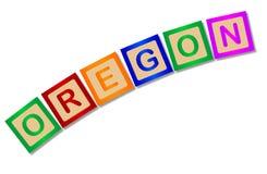 L'Orégon sur les caractères gras en bois d'isolement Images libres de droits