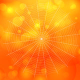 L'orange a brouillé le fond de Halloween de bokeh avec la toile d'araignées, illustration libre de droits