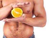 L'orange est des mains Photos libres de droits