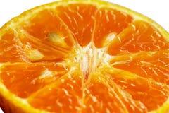 L'orange obtient de couper dans la moitié Photo libre de droits