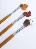 L'orange trois composent des balais Photographie stock libre de droits