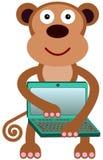 L'ordinateur portable du singe Images libres de droits