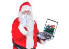 l'ordinateur portatif de Claus de sac présente l'écran de Santa Photographie stock libre de droits