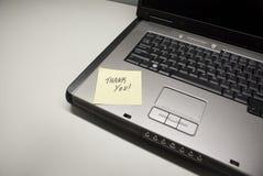 l'ordinateur portatif vous remercient photo stock