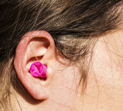 L'orecchio della donna tappata fotografie stock libere da diritti