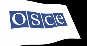 L'organisation d'OSCE pour sécurité et coopération en Europe marquent l'ondulation lente dans la perspective, longueur de l'anima illustration libre de droits