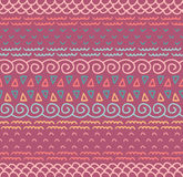 L'ornamentale indigeno decorativo del tessuto etnico ha barrato il modello senza cuciture nel vettore Fondo senza fine di colore Fotografie Stock