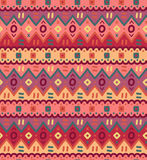 L'ornamentale indigeno decorativo luminoso del tessuto etnico ha barrato il modello senza cuciture Immagine Stock Libera da Diritti