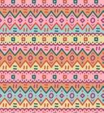 L'ornamentale indigeno decorativo luminoso del tessuto etnico ha barrato il modello senza cuciture Fotografia Stock